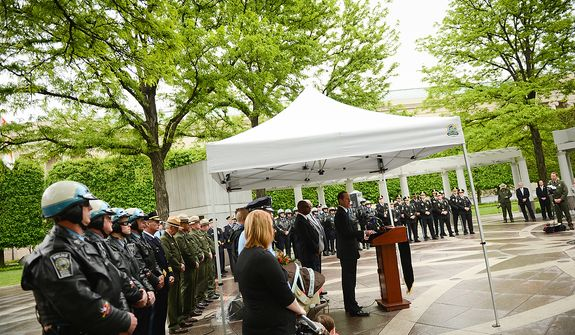 Police officers stand in line during a ceremony to unveil the name of slain Prince William County Police Officer Chris Yung on the wall of the National Law Enforcement Memorial, Washington, D.C., Monday, April 29, 2013. Yung was killed in a motorcycle accident while responding to a separate car crash New Years Eve last year. (Andrew Harnik/The Washington Times)