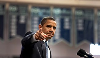 ** FILE ** President Obama points to a member of the audience at a meeting in Rio Rancho, New Mexico, May 14, 2009. (Official White House Photo by Pete Souza)