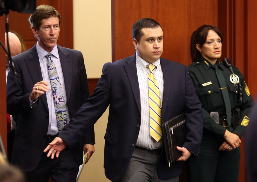 George Zimmerman, defendant in the killing of Trayvon Martin, arrives in Seminole circuit court, in Sanford, Fla., with his attorney Mark O'Mara, left, for a pre-trial hearing, Tuesday, April 30, 2013. (AP Photo/Orlando Sentinel, Joe Burbank, Pool)