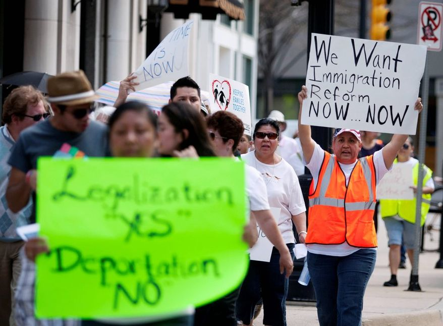 Martina Cano joins others in a May Day march for immigration reform in Grand Rapids, Mich.