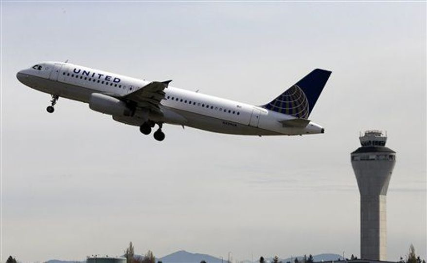 ** FILE ** A United Airlines jet departing in view of the air traffic control tower at Seattle-Tacoma International Airport in Seattle, April 23, 2013.