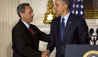 President Obama shakes hands with Rep. Mel Watt, North Carolina Democrat and Obama's nominee for the Federal Housing Finance Authority director, on May 1, 2013, in the State Dinning Room of the White House in Washington, where he made the announcement of the nomination. (Associated Press)