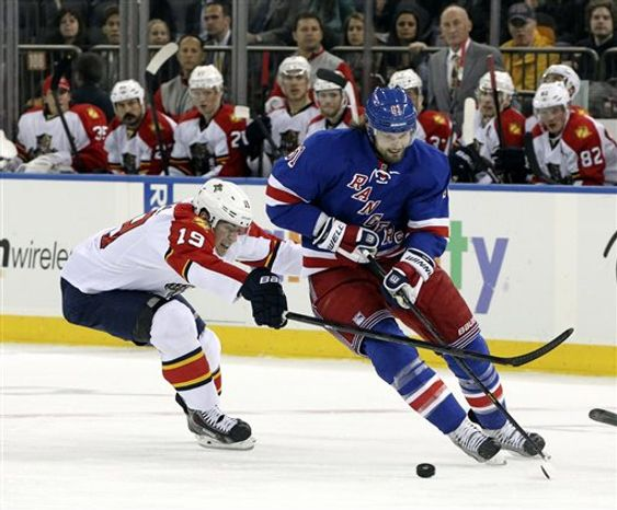 Florida Panthers' Scottie Upshall (19) battles for the puck against New York Rangers' Rick Nash during the second period of an NHL hockey game Thursday, April 18, 2013 at Madison Square Garden in New York. (AP Photo/Mary Altaffer)