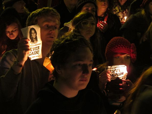 Protesters for abortion rights hold a vigil for Savita Halappanavar outside Ireland's government headquarters in Dublin on Saturday, Nov. 17, 2012. (AP Photo/Shawn Pogatchnik)