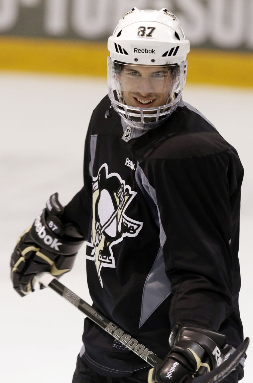 Pittsburgh Penguins' Sidney Crosby participates in NHL hockey practice in Canonsburg, Pa., Tuesday, April 30, 2013. The Penguins take on the New York Islanders in the first round of the NHL hockey playoffs on Wednesday, May 1, in Pittsburgh. Crosby hasn't played since breaking his jaw a month ago. (AP Photo/Gene J. Puskar)