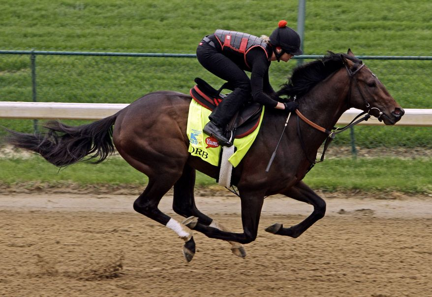 In this Monday, April 29, 2013, file photo, exercise rider Jenn Patterson rides Kentucky Derby entrant Orb for a workout at Churchill Downs in Louisville, Ky. Orb has been made the early 7-2 favorite for the Kentucky Derby on Wednesday, May 1, 2013, with undefeated Verrazano the second choice in a full field of 20 horses. (AP Photo/Garry Jones, File)