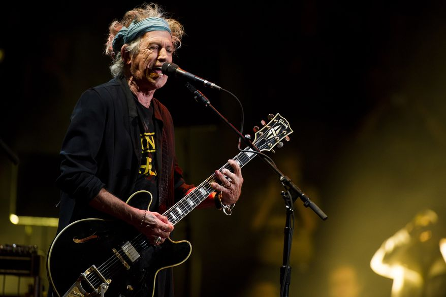 Keith Richards performs at Eric Clapton's Crossroads Guitar Festival 2013 at Madison Square Garden in New York on Saturday, April 13, 2013, (Charles Sykes/Invision/AP)