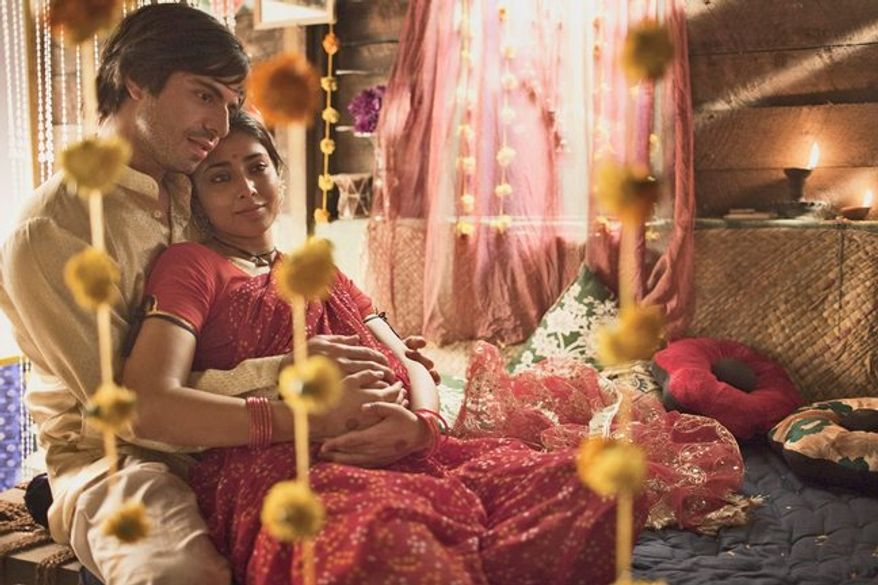 """""""Midnight's Children's"""" characters embody and live out India's tumultuous transition from British rule to independent nationhood. Saleem Sinai, played by Satya Bhabha in a scene with Shriya Saran, is the illegitimate son of a poor woman and a wealthy Englishman."""