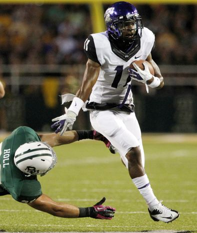 Baylor safety Sam Holl (25) is unable to stop TCU wide reciever Skye Dawson (11) after a reception in the first half of an NCAA college football game Saturday, Oct. 13, 2012, in Waco, Texas. (AP Photo/Tony Gutierrez)