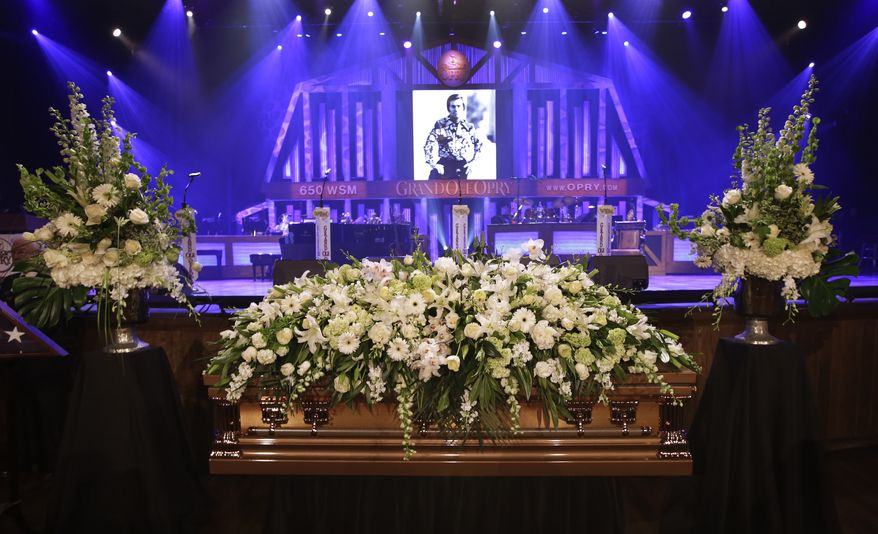 The casket of country music legend George Jones sits in the Grand Ole Opry House before his funeral on Thursday, May 2, 2013, in Nashville, Tenn. Mr. Jones, one of country's biggest stars, who had No. 1 hits in four different decades, died Friday at age 81. (AP Photo/Mark Humphrey, Pool)