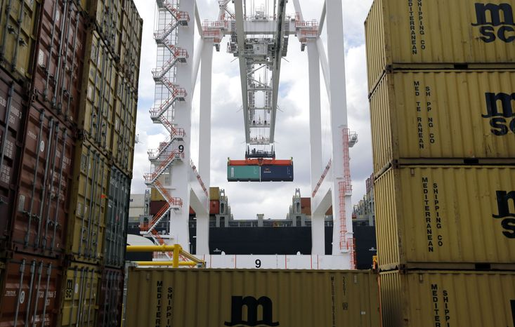A crane removes a container from a ship at the Port of Baltimore's Seagirt Marine Terminal on Friday, March 1, 2013. (AP Photo/Patrick Semansky)