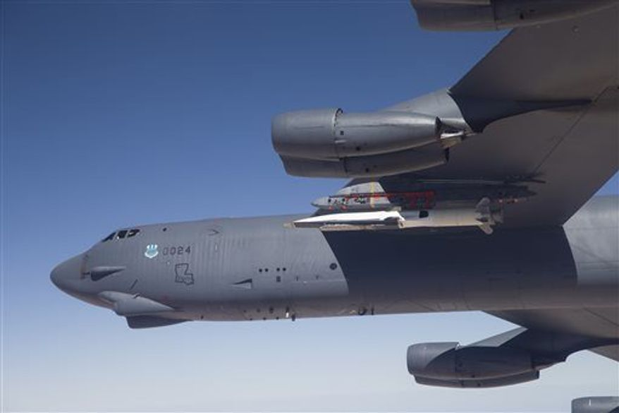 In this Wednesday, May 1, 2013 photo released by the U.S. Air Force, the X-51A Waverider, carried under the wing of a B-52H Stratofortress bomber, prepares to launch for its fourth and final flight over the Pacific Ocean. The X-51A, an experimental, unmanned aircraft developed for the U.S. Air Force, went hypersonic during a test off the Southern California coast, traveling at more than 3,000 mph, the Air Force said Friday. (Associated Press)