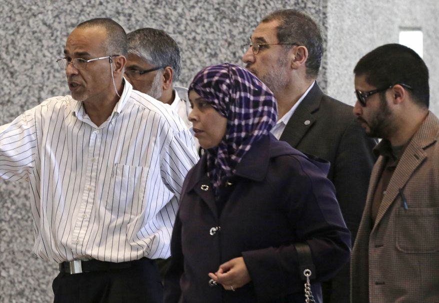 Family and supporters of 18-year-old Abdella Ahmad Tounisi, including his father, Ahmad Tounisi, left, leave federal court Thursday, May 2, 2013, in Chicago, after a federal judge agreed to release the Illinois teenager charged with trying to join an al-Qaeda-linked militant group in war-torn Syria. (AP Photo/M. Spencer Green)