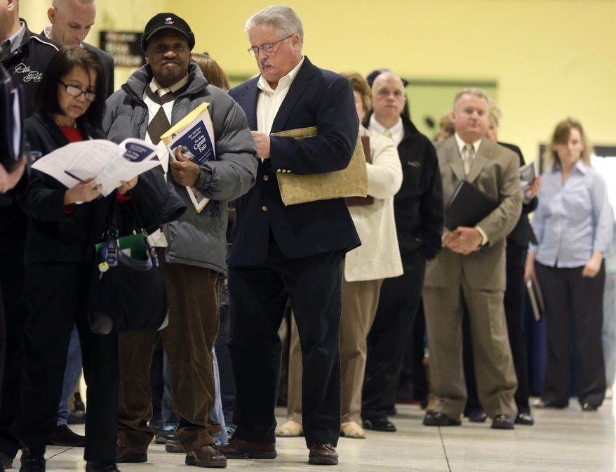 In this Thursday, April 11, 2013, photo, people wait in line before the Dr. King Career Fair at the Empire State Plaza Convention Center in Albany, N.Y. (AP Photo/Mike Groll)