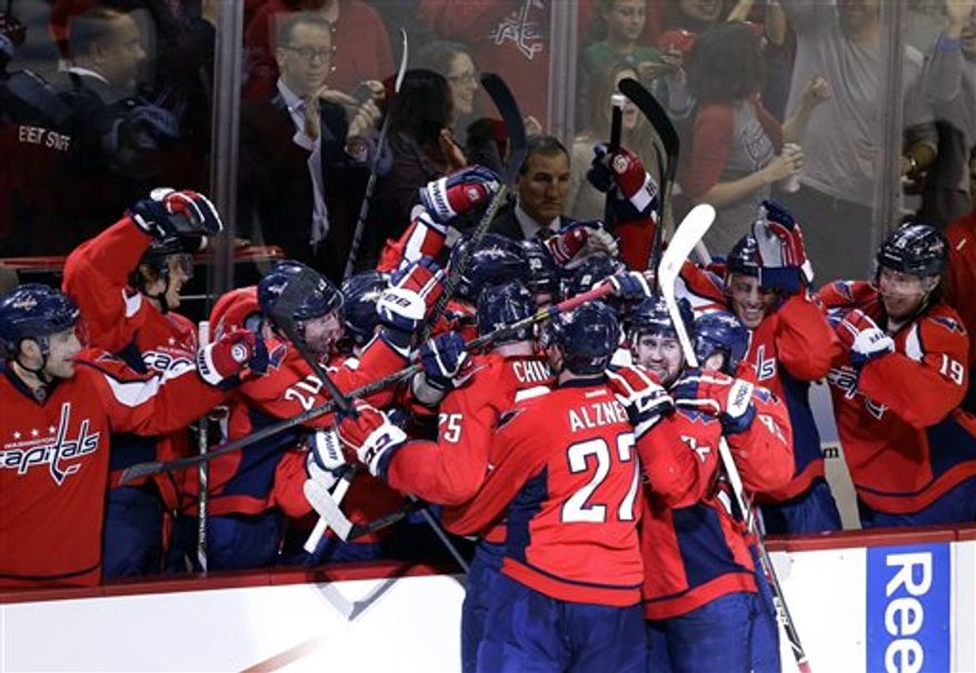The Washington Capitals celebrate a goal by eft wing Jason Chimera (25) in the second period of Game 1 of a Stanley Cup NHL playoff hockey series against the New York Rangers, Thursday, May 2, 2013, in Washington. (AP Photo/Alex Brandon)