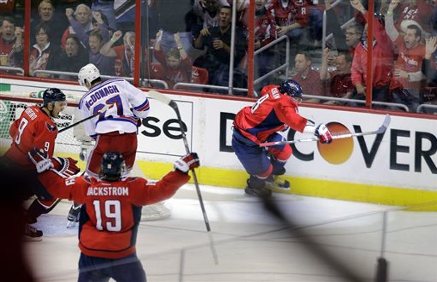 Washington Capitals left wing Alex Ovechkin (8), from Russia, celebrates his goal in the second period of Game 1 of a Stanley Cup NHL playoff hockey series against the New York Rangers, Thursday, May 2, 2013, in Washington. (AP Photo/Alex Brandon)