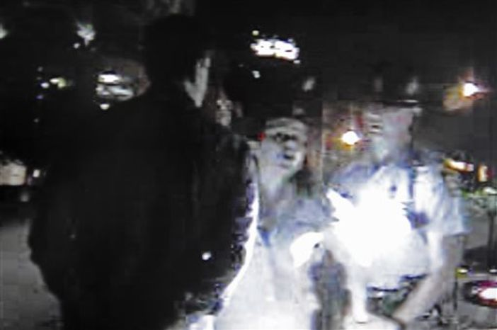 ** FILE ** In this video screen still image released by the Georgia State Police, Friday, May 3, 2013, actress Reese Witherspoon speaks with a Georgia State Trooper, in Atlanta. Her husband, Hollywood agent Jim Toth, is seen at left being arrested for suspicion of being under the influence on April 19. (AP Photo/Georgia State Police)