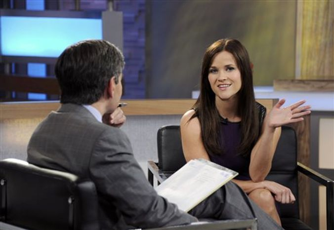 """This image released by ABC news shows co-host George Stephanopoulos, left, interviewing actress Reese Witherspoon on """"Good Morning America,"""" Thursday, May 2, 2013 in New York. During the interview, Witherspoon repeatedly apologized for her behavior during an April 19 traffic stop in Georgia. (AP Photo/ABC, Ida Mae Astute)"""