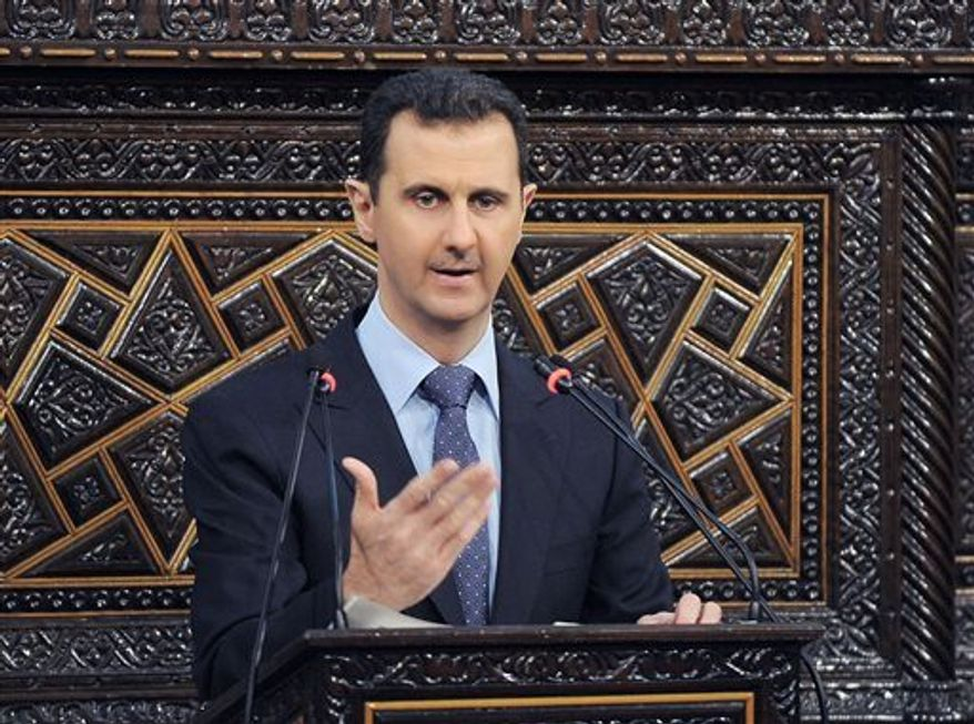 ** FILE ** Syrian President Bashar Assad delivers a speech at the parliament in Damascus, Syria, June 3, 2012. Israel launched an airstrike into Syria on Friday, May 3, 2013, apparently targeting a suspected weapons site, U.S. officials said Friday night, May 3, 2013. (AP Photo/SANA, File)