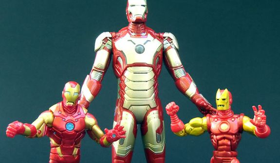 Hasbro's Arc Strike Iron Man stands over Marvel Legends' Heroic Age Iron Man and Classic Iron Man. (Photograph by Joseph Szadkowski / The Washington Times)