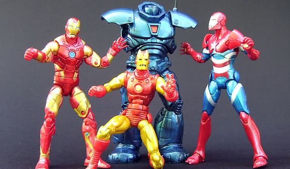 Hasbro's latest Marvel Legends' collection includes Heroic Age Iron Man, Classic Iron Man (with horned mask) and Iron Patriot along with pieces to begin building the Iron Monger figure. Collectors need to wait for the next series of Marvel Legends to finish building the figure.  (Photograph by Joseph Szadkowski / The Washington Times)