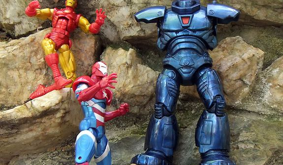 Hasbro's Marvel Legends' Classic Iron Man (with alternate head) and Iron Patriot with the Build A Figure Iron Monger (a work still in progress). (Photograph by Joseph Szadkowski / The Washington TImes)