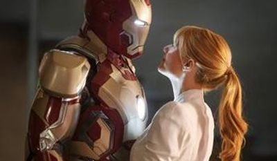 "Robert Downey Jr., left, as Tony Stark/Iron Man and Gwyneth Paltrow as Pepper Potts in a scene from ""Iron Man 3.""  (AP Photo/Disney, Marvel Studios)"