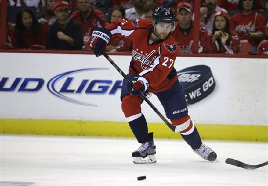 Karl Alzner deflected the puck over the glass in Game 2 Saturday, but his was not one of two delay-of-game penalties called. (Associated Press)
