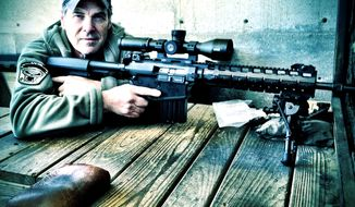 Texas Gov. Rick Perry with a LaRue Tactical AR-type rifle.