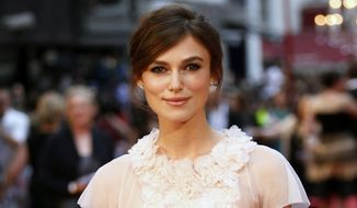 "British actress Keira Knightley poses as she arrives for the world premiere of ""Anna Karenina"" in London on Tuesday, Sept. 4, 2012. (AP Photo/Sang Tan)"