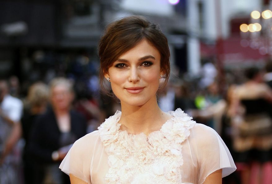 """British actress Keira Knightley poses as she arrives for the world premiere of """"Anna Karenina"""" in London on Tuesday, Sept. 4, 2012. (AP Photo/Sang Tan)"""