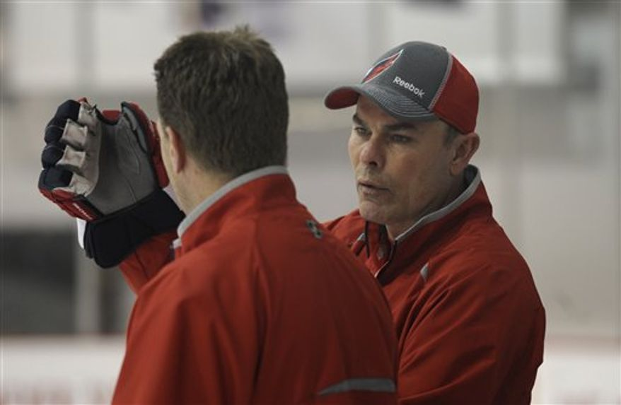 Washington Capitals coach Adam Oates, right, runs drills during a hockey practice at the Kettler Capitals Iceplex in Arlington, Va. Tuesday, April 30, 2013. The Capitals will face the New York Rangers in the first round of the Eastern Conference playoffs starting Thursday at the Verizon Center in Washington. (AP Photo/Susan Walsh)