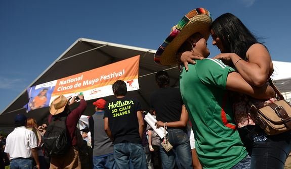 Pedro Hernandez of Washington dances with his girlfriend to music by a live mariachi band at the annual Cinco de Mayo celebration on the National Mall in Washington on Sunday, May 5, 2013. (Andrew Harnik/The Washington Times)