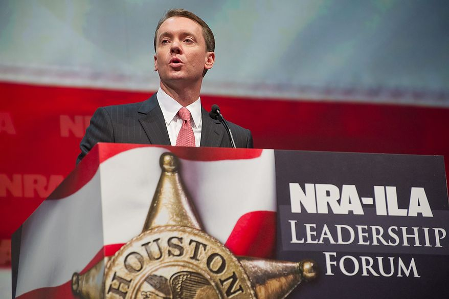 National Rifle Association's Institute for Legislative Action executive director Chris W. Cox speaks during the leadership forum at the National Rifle Association's annual convention Friday, May 3, 2013 in Houston. (AP Photo/Steve Ueckert)