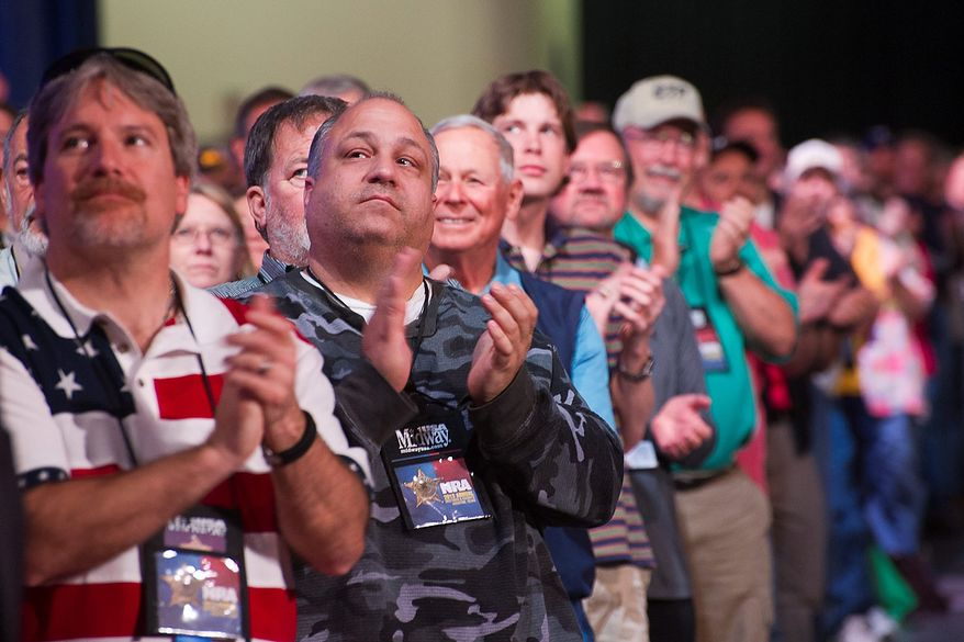 Attendees applaud a speaker during the leadership forum at the National Rifle Association's annual convention Friday, May 3, 2013 in Houston. (AP Photo/Steve Ueckert)