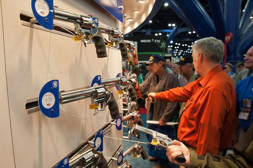 ** FILE ** Smith and Wesson pistols are on display during the National Rifle Association's annual convention Friday, May 3, 2013, in Houston. (AP Photo/Steve Ueckert)