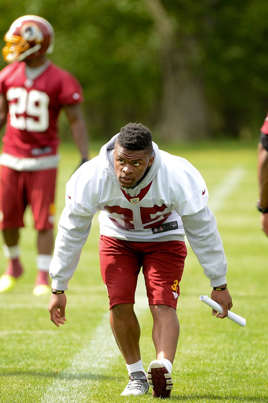 Newly drafted Washington Redskins running back Chris Thompson (35) warms up at the team's rookie minicamp at Redskins Park in Ashburn, Va., on Sunday, May 5, 2013. (Andrew Harnik/The Washington Times)