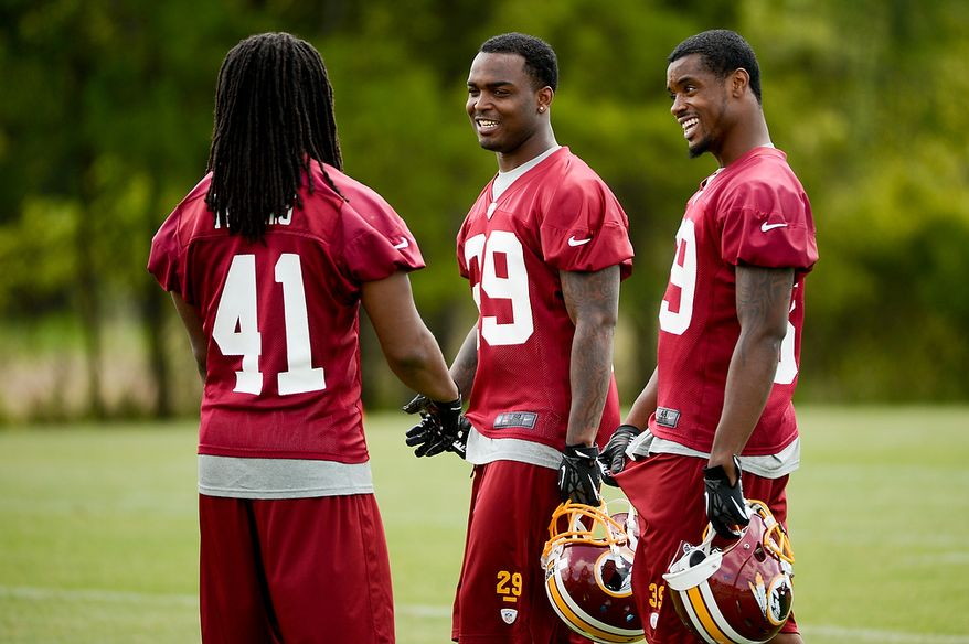 Newly drafted Washington Redskins safety (from left) Phillip Thomas (41), safety Bacarri Rambo (29) and cornerback David Amerson (39) talk on the sidelines during the team's rookie minicamp at Redskins Park in Ashburn, Va., on Sunday, May 5, 2013. (Andrew Harnik/The Washington Times)