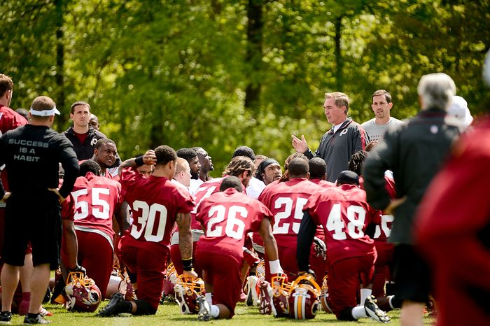 Washington Redskins head coach Mike Shanahan talks to players at the team's rookie minicamp at Redskins Park in Ashburn, Va., on Sunday, May 5, 2013. Also pictured is Washington Redskins offensive coach Kyle Shanahan (right). (Andrew Harnik/The Washington Times)