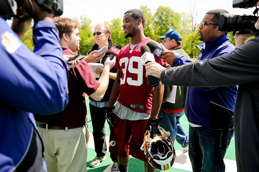 Newly drafted Washington Redskins cornerback David Amerson (39) talks to members of the media following rookie minicamp at Redskins Park in Ashburn, Va., on Sunday, May 5, 2013. Also pictured is tryout cornerback Akeem Auguste (second from left). (Andrew Harnik/The Washington Times)