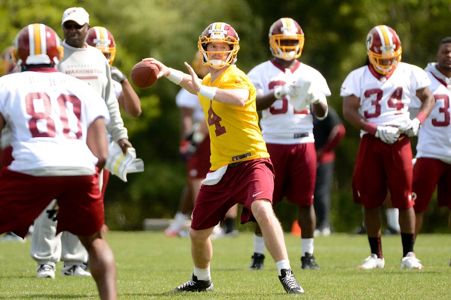 Quarterback Matthew McGloin (4) passes during a drill at the Washington Redskins' rookie minicamp at Redskins Park in Ashburn, Va., on Sunday, May 5, 2013. (Andrew Harnik/The Washington Times)