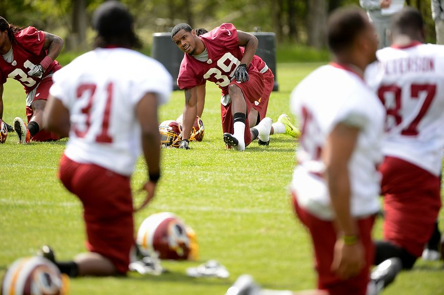 Newly drafted Washington Redskins cornerback David Amerson (39) stretches at the beginning of the team's rookie minicamp at Redskins Park in Ashburn, Va., on Sunday, May 5, 2013. (Andrew Harnik/The Washington Times)