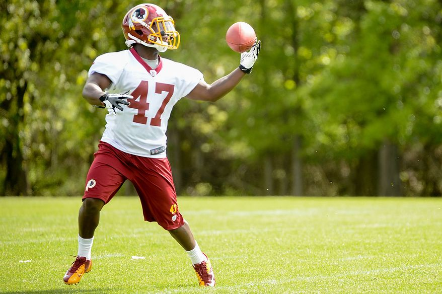 Newly drafted Washington Redskins running back Jawan Jamison (47) catches a pass at the team's rookie minicamp at Redskins Park in Ashburn, Va., on Sunday, May 5, 2013. (Andrew Harnik/The Washington Times)