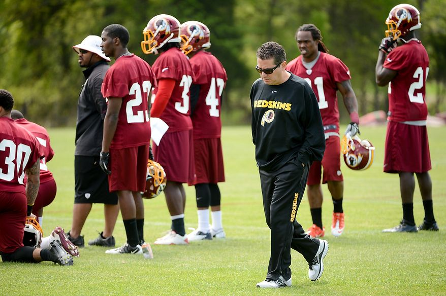 Washington Redskins owner Dan Snyder walks the sidelines during the team's rookie minicamp at Redskins Park in Ashburn, Va., on Sunday, May 5, 2013. (Andrew Harnik/The Washington Times)