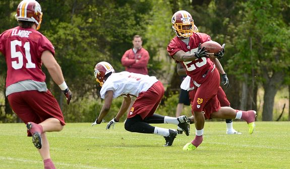 Washington Redskins safety Bacarri Rambo (29) makes an interception during a scrimmage at the team's rookie minicamp at Redskins Park in Ashburn, Va., on Sunday, May 5, 2013. (Andrew Harnik/The Washington Times)