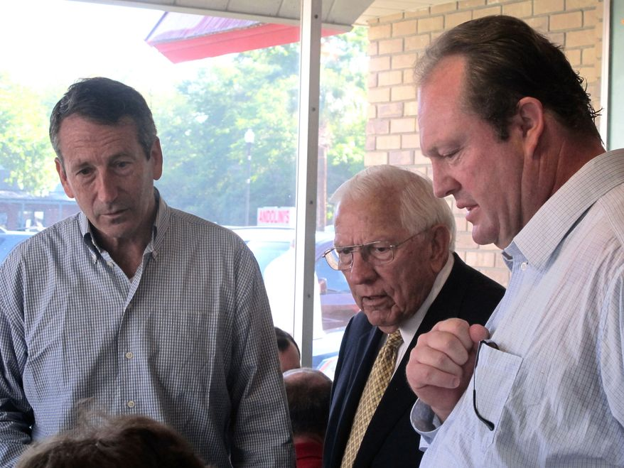 Former South Carolina Govs. Mark Sanford (left) and Jim Edwards and state Rep. Chip Limehouse, who lost to Sanford in the March primary for the state's open House seat, speak with voters during a campaign stop at a diner in Mount Pleasant, S.C., on May 6, 2012. Sanford faces Elizabeth Colbert Busch, the sister of comedian Stephen Colbert, in a special congressional election in the state's 1st District. (Associated Press)