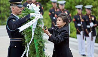 South Korea President Park Geun-hye lays a wreath Monday at the Tomb of the Unknowns at Arlington National Cemetery. She meets with President Obama on Tuesday at the White House. (associated press)