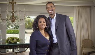 """Oprah Winfrey with NBA basketball player Jason Collins during an interview for """"Oprah's Next Chapter,"""" in Beverly Hills, Calif. Officials at three publishing houses said Monday that they had been contacted about a planned memoir by Collins, the first active player in any of four major U.S. professional sports leagues to come out as gay.  (AP Photo/OWN, Chuck Hodes)"""