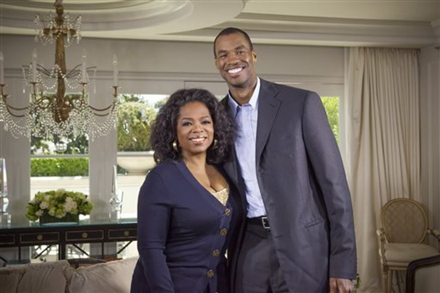 "Oprah Winfrey with NBA basketball player Jason Collins during an interview for ""Oprah's Next Chapter,"" in Beverly Hills, Calif. Officials at three publishing houses said Monday that they had been contacted about a planned memoir by Collins, the first active player in any of four major U.S. professional sports leagues to come out as gay.  (AP Photo/OWN, Chuck Hodes)"