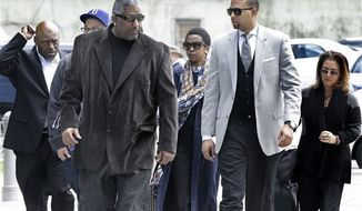 Singer Lauryn Hill was sentenced Monday to three months in prison for failure to pay federal taxes on $1.8 million earned from 2005 to 2007. The eight-time Grammy winner, center, is shown walking to federal court in Newark, N.J. (AP Photo/Mel Evans)